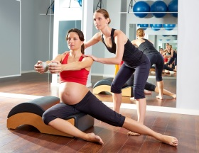 pregnant woman pilates side stretchs exercise